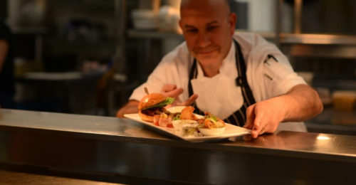 chef presenting plate of food